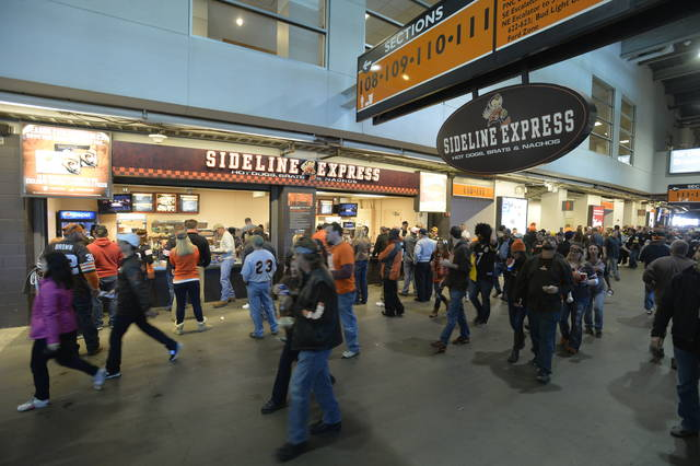 <p>In this Oct. 12, 2014, file photo, fans walk past food concession stands prior to an NFL football game between the Cleveland Browns and the Pittsburgh Steelers, in Cleveland.</p>