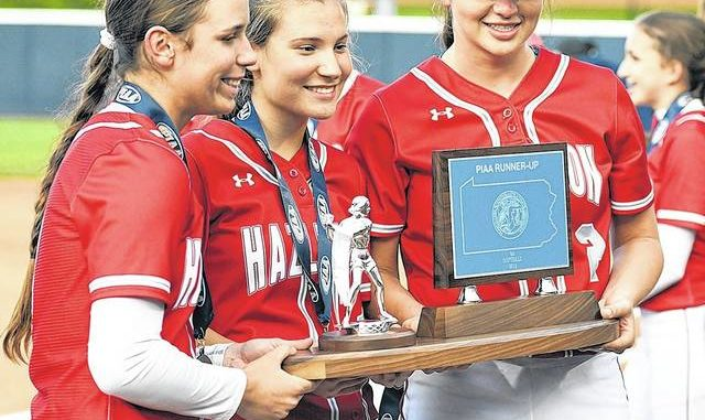 Hazleton Area's Julia Mrochko, Aleah Kost and Marissa Trivelpiece accept the runner-up trophy at last year's PIAA Class 6A state championship gameat Penn State. The COVID-19 pandemic ended the Cougars' chance to return to the title game. Tony Callaio file photo | For Times Leader
