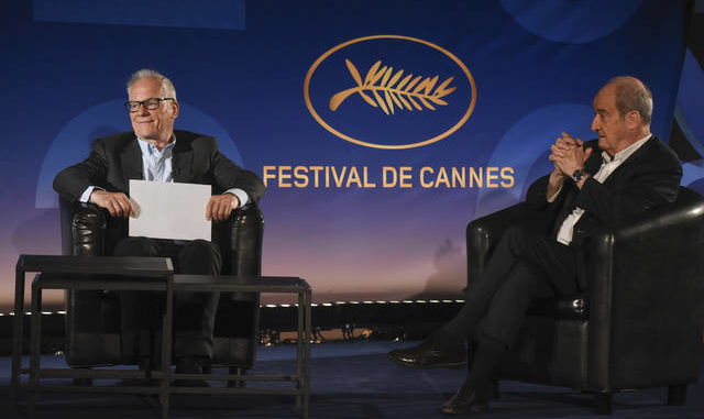 "Cannes Festival director Thierry Fremaux, left, festival president Pierre Lescure, sit during the presentation of the festival lineup, in an empty cinema Wednesday, June 3, 2020 in Paris. The Cannes Film Festival was canceled due to the pandemic but it announced the films that would have played at the French Riviera festival. Those films, festival organizers say, will be able to promote themselves with the Cannes ""stamp of approval."" (Serge Arnal, Pool via AP)"