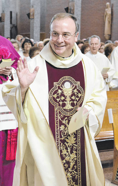 <p>Father Paul McDonnell, a native of West Pittston, is shown waving to his parents, Shirley and Thomas McDonnell, during the celebration of his 25th year as an ordained priest in 2016.</p> <p>Tony Callaio | For Sunday Dispatch</p>