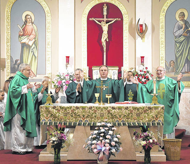 <p>Father Paul McDonnell (center) celebrates Mass at St. Joseph Marello Parish Church for the last time as an Oblates of St. Joseph run church before it was handed over to Diocese of Scranton. Left to right: Fr. Daniel Schwebs, Fr. Ray Tabon, Deacon Santo Agolino, McDonnell, Fr. Jackson Pinheiro, Fr. Joseph Sibilano.</p> <p>Tony Callaio | For Sunday Dispatch</p>