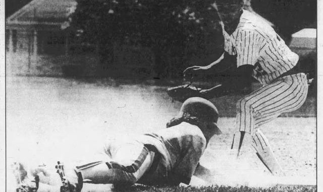Lake-Lehman's Rick Titus dives back to base as Newport's Brad Harris applies the tag during a PIAA Class 2A quarterfinal game in 1987 at the North Berwick field. Times Leader file photo