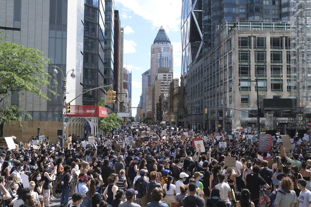 <p>Protesters march through the streets of Manhattan on Sunday.</p> <p>AP photo</p>