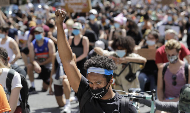 Protesters march through the streets of Manhattan on Sunday. New York City lifted the curfew spurred by protests against police brutality ahead of schedule Sunday after a peaceful night, free of the clashes or ransacking of stores that rocked the city days earlier. AP photo