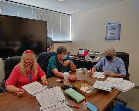 Luzerne County Election Board members Joyce Dombroski-Gebhardt, Keith Gould and Peter Ouellette are seen continuing to review primary election ballots on Monday. Submitted photo