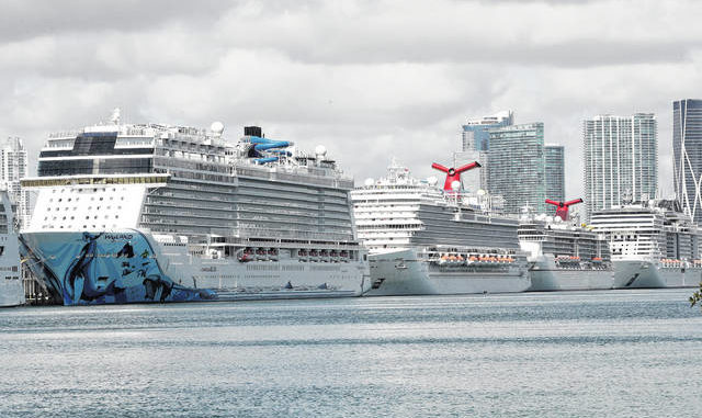 In this March 31, 2020, file photo, cruise ships are docked at PortMiami in Miami. The cruise industry hopes to set sail later this summer. AP photo