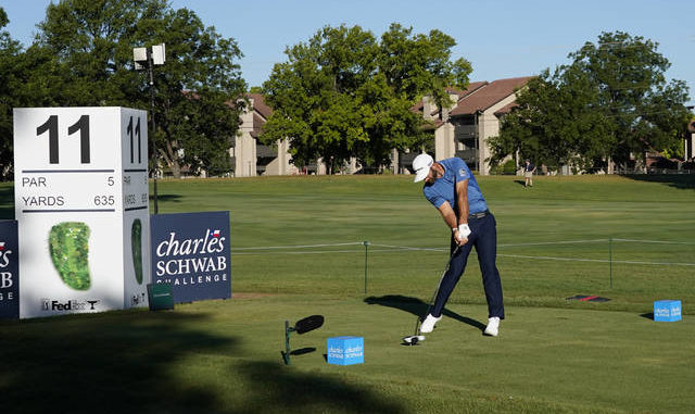 Dustin Johnson tees off at the 11th hole during the first round of the Charles Schwab Challenge at Colonial on Thursday. David J. Phillip   AP photo