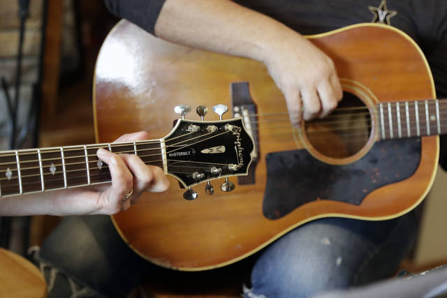 <p>Nurse Megan Palmer, left, and care partner Anna Henderson, who both work at Vanderbilt University Medical Center, appear during a songwriting session at Henderson's home in Ashland City, Tenn.</p> <p>AP photo</p>