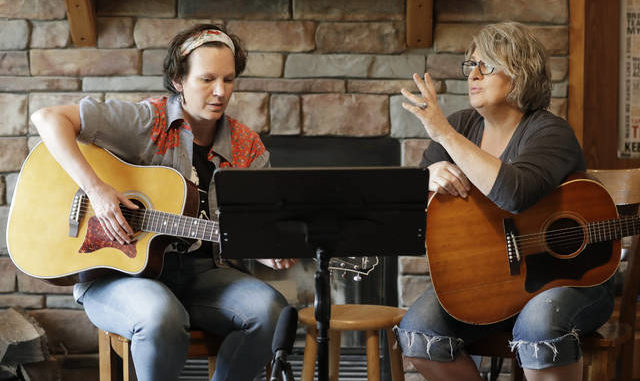Nurse Megan Palmer, left, and care partner Anna Henderson, who both work at Vanderbilt University Medical Center, appear during a songwriting session at Henderson's home in Ashland City, Tenn. During the COVID-19 pandemic, their role as caregivers has become even more important as hospital visits from family and friends were limited or prohibited to prevent the spread of the virus. Music and songwriting has helped them express the complexity of emotions that comes with caregiving, especially in the time of a pandemic. AP photo