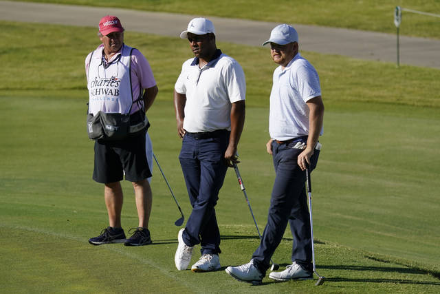 <p>From right, Zac Blair, Harold Varner III and caddie Rick Wynn observe a moment of silence to pay their respects to the memory of George Floyd on the 16th hole Friday.</p> <p>David J. Phillip   AP photo</p>