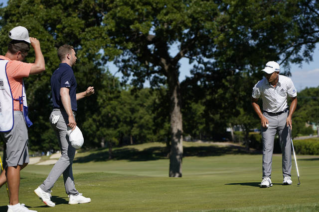 <p>Daniel Berger, second left, walks over to Coilin Morikawa after winning Charles Schwab Challenge at the Colonial Country Club in Fort Worth, Texas, on Sunday. Morikawa missed his putt on the first playoff hole.</p> <p>AP photo</p>
