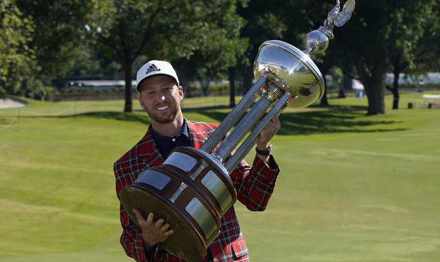 Daniel Berger poses with the championship trophy after winning the Charles Schwab Challenge after a playoff round at the Colonial Country Club in Fort Worth, Texas, on Sunday. AP photo
