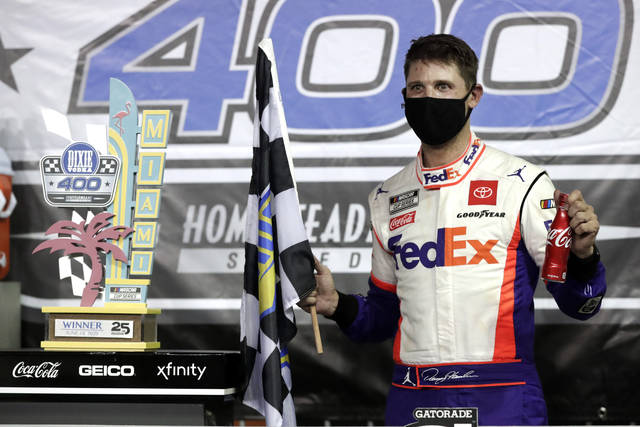 <p>Denny Hamlin celebrates after winning a NASCAR Cup Series race Sunday in Homestead, Fla.</p> <p>AP photo</p>