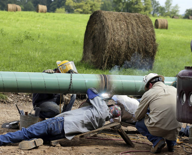 <p>Welders from Linde Corporation work on a well pipe at the Cabot Oil & Gas Friedland Farms Pad 1, Lenox Township, Susquehanna County in 2014.</p> <p>Times Leader file photo</p>