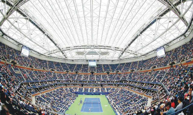 Flushing Meadows is set to host the U.S. Open as usual this year, but the stands will be empty for the first Grand Slam event scheduled since the coronavirus shutdown. Adam Hunger | AP file photo