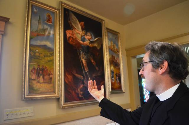 <p>'We wanted to tell the story of the parish history in art,' said the Rev. Thomas Petro, explaining why the church commissioned the artwork from artist Henry Antoni Pospieszalski of Hop Bottom, Susquehanna County.</p> <p>Mark Guydish | Times Leader</p>