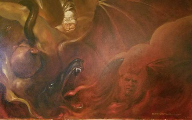 <p>The head of a dog, body of a serpent and bat-like wings all blend into the representation of the devil in the good-versus-evil portion of the triptych.</p> <p>Mark Guydish | Times Leader</p>