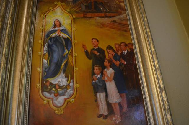 <p>The depiction of present-day parishioners shows them praying the rosary near a representation of Our Lady of the Immaculate Conception, who is also depicted on a stained glass window in Sacred Heart of Jesus Church.</p> <p>Mark Guydish | Times Leader</p>