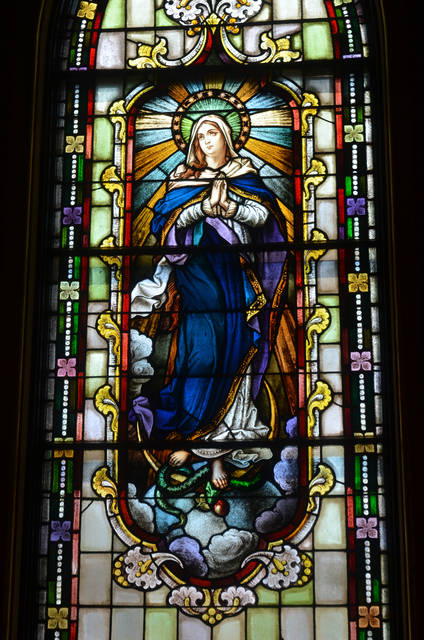 <p>Artist Henry Antoni Pospieszalski used this stained glass window in Sacred Heart of Jeus Church, Dupont, as inspiration for part of his triptych.</p> <p>Mark Guydish | Times Leader</p>