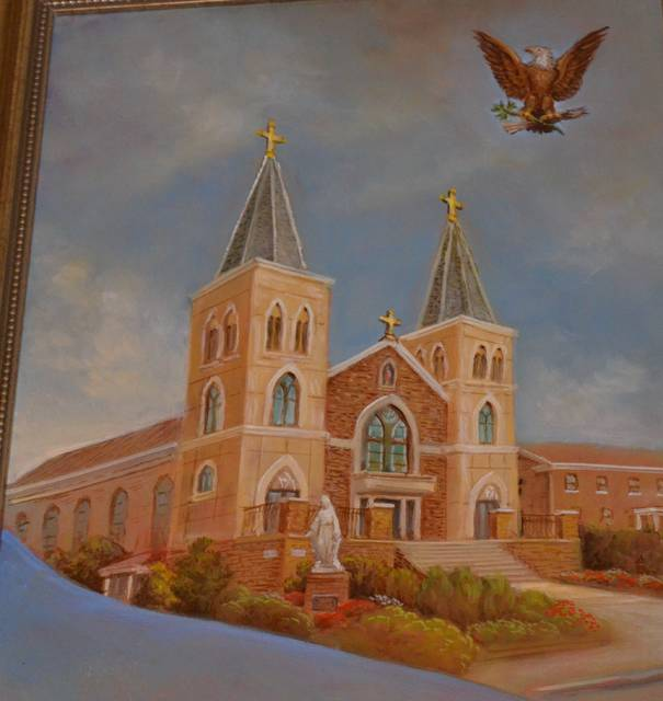 <p>The triptych shows a representation of Sacred Heart of Jesus Church in Dupont, with the American eagle overhead.</p> <p>Mark Guydish | Times Leader</p>