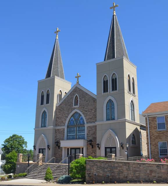 <p>This is a street view of Sacred Heart of Jesus Church on Lackawanna Avenue in Dupont, which recently celebrated 100 years since the dedication of its current building.</p> <p>Mark Guydish | Times Leader</p>