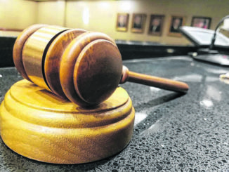 District Judge cited with harassment; President judge reassigns criminal cases