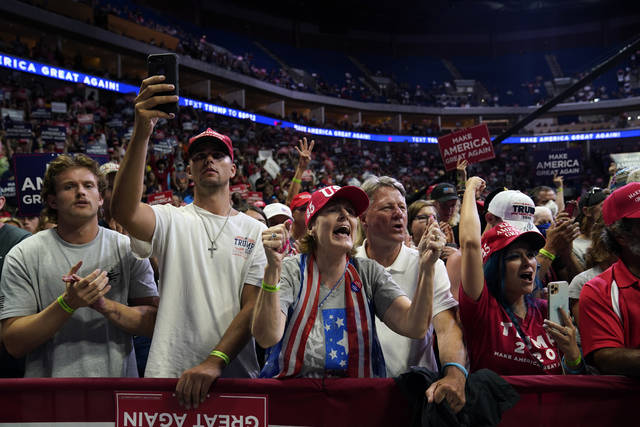 <p>President Donald Trump supporters cheer as they attend a campaign rally at the BOK Center, Saturday, June 20, 2020, in Tulsa, Okla. (AP Photo/Evan Vucci)</p>