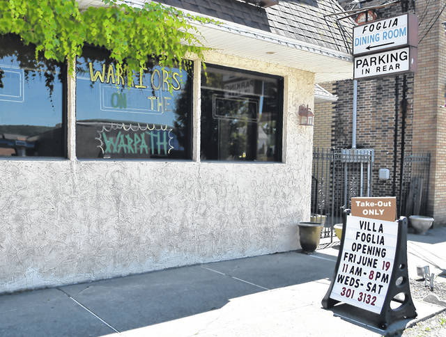 <p>Earlier in the week, Bernie Foglia, former owner of Villa Foglia, put a sign out in front of the his establishment he will reopen this weekend.</p> <p>Tony Callaio   For Sunday Dispatch</p>