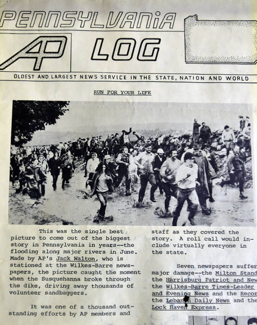 <p>This iconic photograph shows volunteers running from the levee in Kingston when sandbagging couldn't hold back the Susquehanna River in 1972.</p>