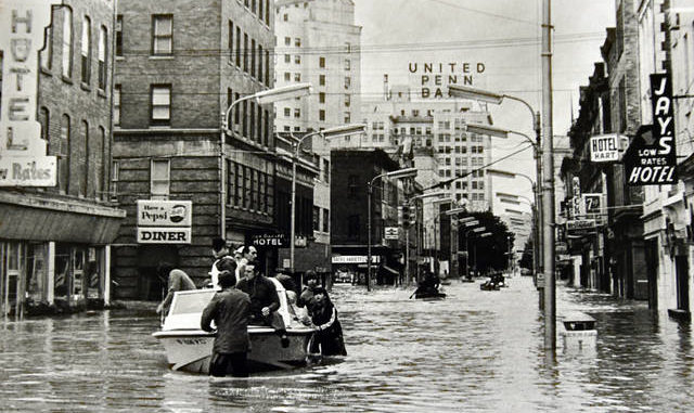 The June 1972 file photo shows flooding on East Market Street looking toward Public Square in June 1972.