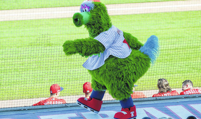 he Phillie Phanatic mascot walks on the third-base dugout while the Philadelphia Phillies played the Pittsburgh Pirates in a spring training baseball game in Clearwater, Fla., in February. AP photo