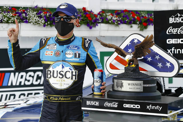 <p>Kevin Harvick celebrates in the winners circle after winning Saturday at Pocono Raceway, the first race of the first Cup Series doubleheader in NASCAR history.</p> <p>Matt Slocum | AP photo</p>