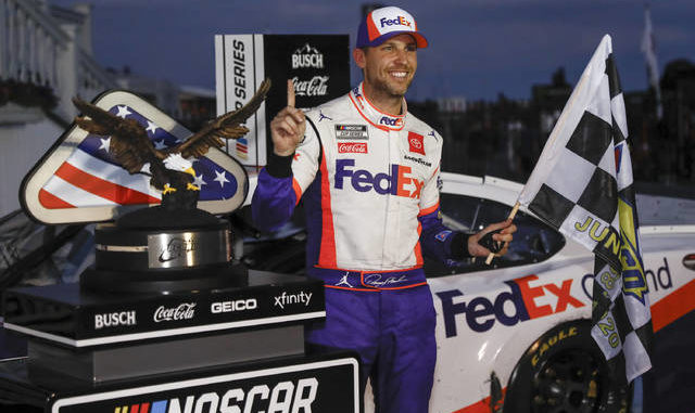 Denny Hamlin capped off what became an unprecedented single-day NASCAR tripleheader with a victory on Sunday at Pocono Raceway. Matt Slocum | AP photo