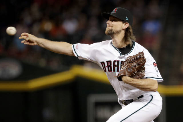 <p>Diamondbacks pitcher Mike Leake has opted out of the 2020 season due to concerns about the coronavirus.</p> <p>Matt York | AP file photo</p>