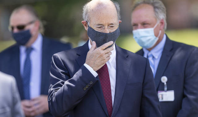 Pennsylvania Gov. Tom Wolf prepares to speak at a press conference outside UPMC Pinnacle Community Osteopathic Hospital near Harrisburg on Monday. Joe Hermitt | The Patriot-News via AP