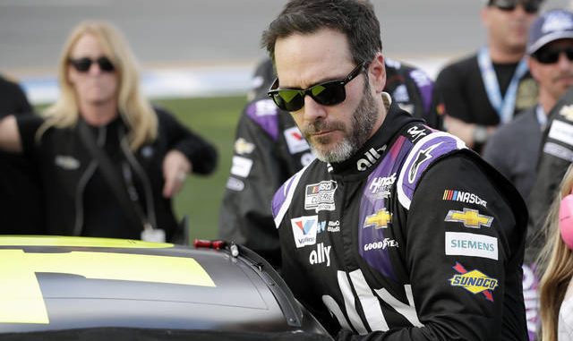 Jimmie Johnson will not race this weekend at the Brickyard after testing positive for the coronavirus. He has not show any symptoms. John Raoux | AP file photo