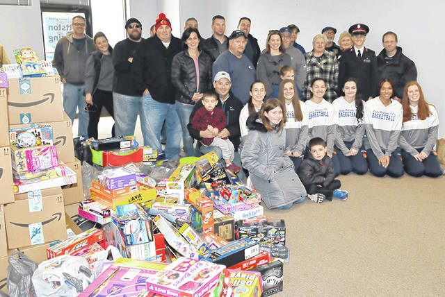 <p>Volunteers of the Greater Pittston Santa Squad stand alongside hundreds of toys donated to the West Pittston Salvation Army for the 2019 Christmas campaign.</p> <p>Tony Callaio | File photo</p>