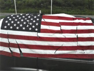 State police: American flag desecrated, vehicle vandalized