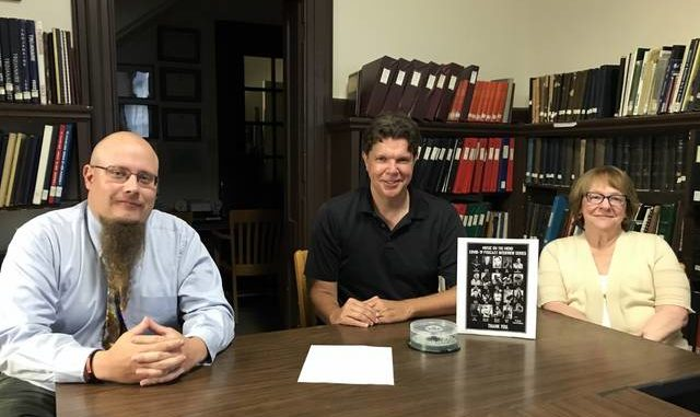 The Luzerne County Historical Society recently received a donation of 19 recorded interviews focusing on the pandemic. The interviews, which were conducted by radio show host Alan K. Stout, discussed how COVID-19 has affected the local arts, entertainment and musical community. Shown, from left: Mark J. Riccetti Jr., director of operations and programs, Luzerne County Historical Society; Alan K. Stout, radio host, The River; Mary Walsh, interim executive director, Luzerne County Historical Society.