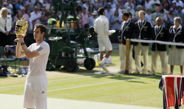 In this July 7, 2013, file photo, Andy Murray of Britain poses with the trophy after defeating Novak Djokovic of Serbia in the men's singles final match at the All England Lawn Tennis Championships in Wimbledon, London. AP photo