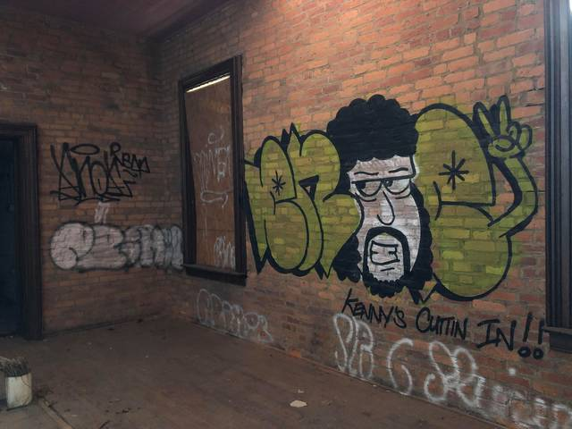 <p>Graffiti is seen in an upstairs room at the station.</p>