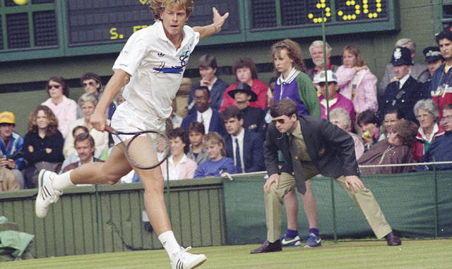 In this July 3, 1988, file photo, Sweden's Stefan Edberg reaches to return to Boris Becker during the men's singles final at Wimbledon. The game was delayed, started and abandoned for the night because of heavy rain. AP file photos