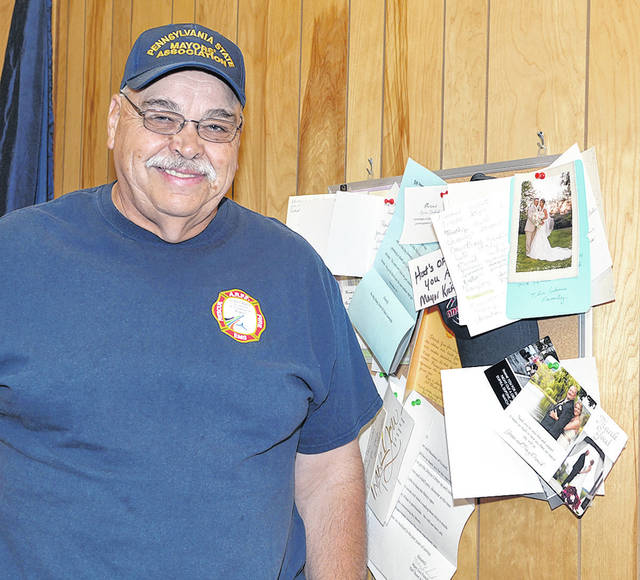 <p>Duryea Mayor Keith Moss stands next to a bulletin board filled with thank you cards and letters from couples he had officiated their wedding ceremonies over the years. Moss estimates he's married approximately 500 couples.</p>                                  <p>Tony Callaio | For Sunday Dispatch</p>