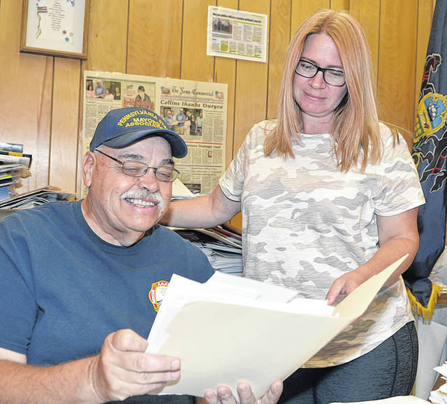 <p>Mayor Keith Moss of Duryea looks over a file from Duryea Borough manager Carolyn Santee.</p>                                  <p>Tony Callaio | For Sunday Dispatch</p>