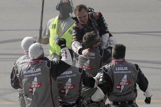 <p>Cole Custer, top, celebrates with his crew after winning a NASCAR Cup Series race Sunday in Sparta, Ky.</p> <p>AP photo</p>