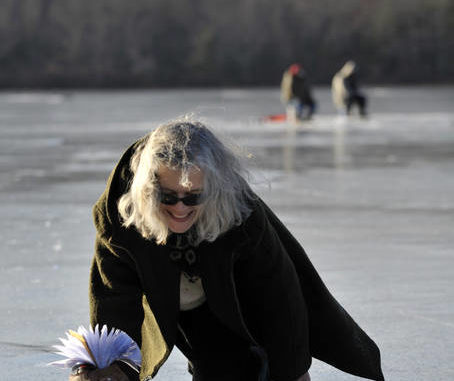 In this photo shot by former Times Leader photographer Pete G. Wilcox, reporter Mary Therese Biebel crawls off the ice of a frozen lake after interviewing two anglers. The unusual little episode is just one of many adventures she's experienced in 39 years of working for the newspaper.