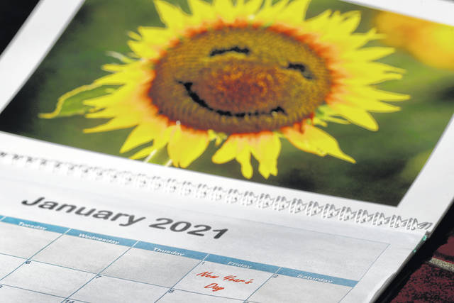 <p>New Year's Day is seen on a 2021 calendar in Overland Park, Kan.</p> <p>AP photo</p>