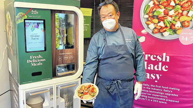 <p>Kang Kuan, vice president of culinary at Chowbotics, holds a custom salad made by his company's robotic salad-making kiosk at the company's headquarters in Hayward, Calif. Prior to this year, Chowbotics had sold over 100 of its $35,000 robots, primarily to hospitals and colleges. But since the coronavirus hit, sales have jumped more than 60%, CEO Rick Wilmer said, with growing interest from grocery stores, senior living communities and even the U.S. Department of Defense.</p>