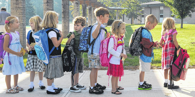 """Kindergarten students line up for the first day of school outside Lehman Jackson Elementary in this Times Leader file photo. With the new restrictions and guidance from the state this week related to the COVID-19 pandemic, school is expected to look very different this fall. Most local districts are planning to maintain """"social distance between students and/or have them wear face masks."""