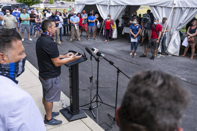 <p>Matt Flinchbaugh, owner of Flinchy's and HomeSlice at Walden, speaks during a rally against Gov. Wolf's new COVID-19 restrictions in restaurants and bars on Friday outside of the Bonefish Grill in Lower Allen Township. near Harrisburg.</p> <p>Joe Hermitt | The Patriot-News via AP</p>